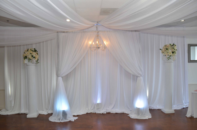 Eventfully Yours Venue in Dallas/Fort Worth Texas microwedding setup with white pillars and draping