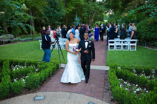 couple walking down microwedding aisle in outdoor ceremony